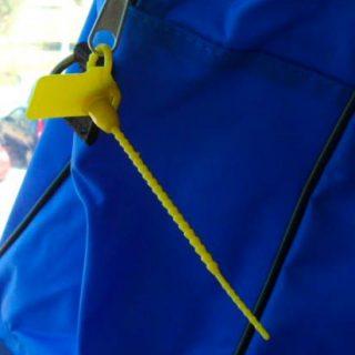 Application Pull Tight Plastic Miniseal On Nilo Bag