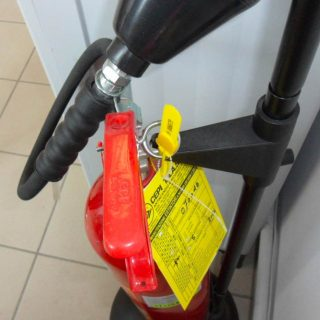 Anchor Application On Handle On Fire Extinguisher